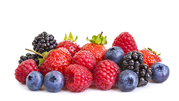 different berries such as blackberries, raspberries, blueberries and strawberries on a white surface