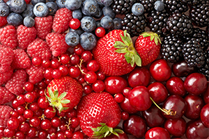 top down view of a bunch of different berries such as blackberries, blueberries, raspberries, and strawberries