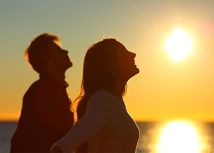 young couple enjoying the sunset together