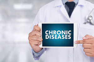 """doctor holding up sign that says """"chronic diseases"""""""