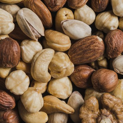 close-up-assorted-nuts_23-2147803726