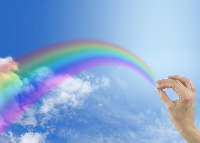 a rainbow in a blue sky