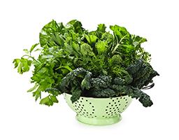 dark leafy greens in a colander