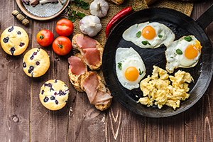 skillet of eggs and other healthy breakfast foods