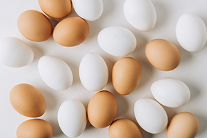 white and brown eggs laid out on a white table