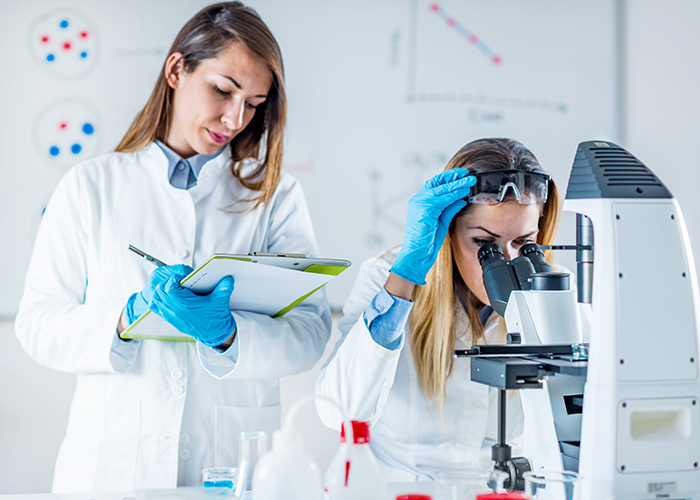 two female researchers working in a lab