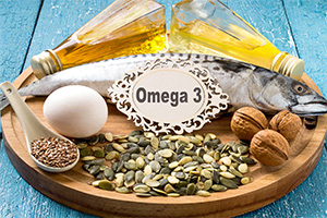 different omega 3-and essential fatty-rich foods such as salmon, eggs, nuts and seeds