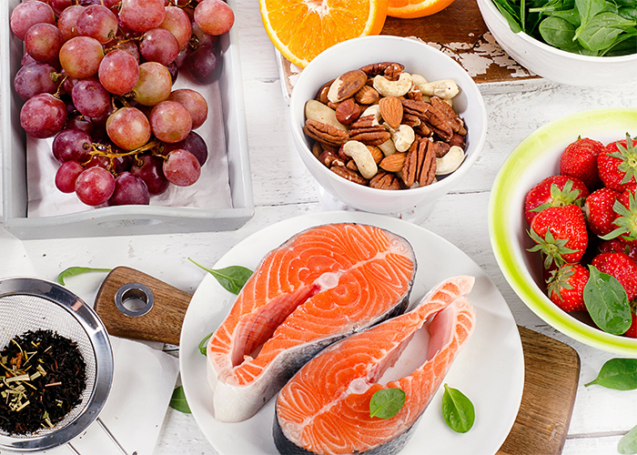 foods rich in antioxidants like salmon, nuts, and produce
