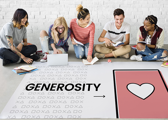 happy young adults around a generosity poster