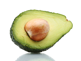 half an avocado against a white background