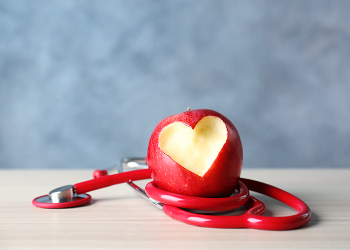 stethoscope wrapped around a red apple