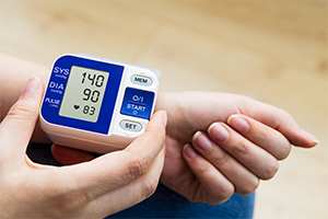 person measuring using a blood pressure machine