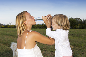 mother drinking water with her son
