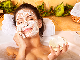 woman applying natural homemade facial mask