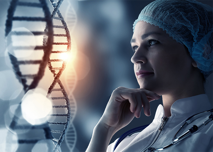 female doctor looking at strand of DNA