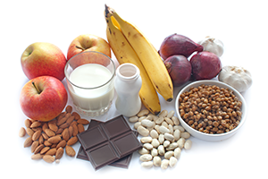 healthy foods like fruits and nuts on a white surface