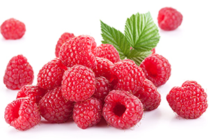 a bunch of fresh raspberries on a white background