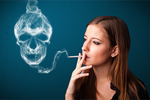 young woman smoking a cigarette against dark blue background