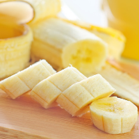 fresh sliced banana on a wooden board