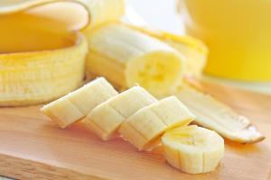 fresh sliced banana on a wooden board