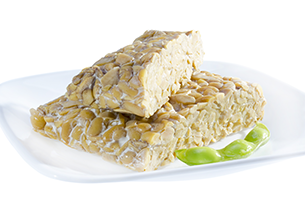 pieces of tempeh on a white plate