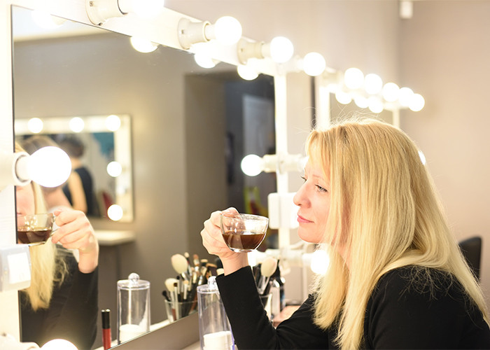 woman looks at herself in the mirror