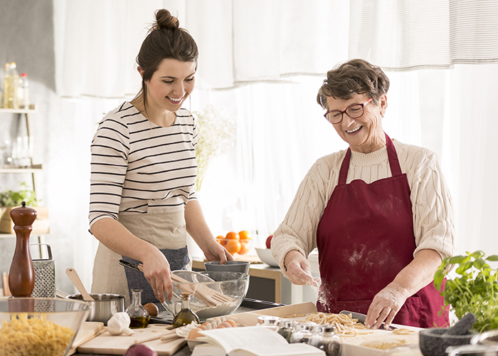 two women preparing a gluten-free meal together in the kitchen